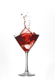 Red cocktail drink splash Stock Images