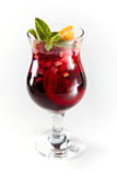 Red cocktail with fruits in a glass Stock Photos