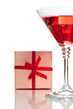 Red cocktail with gift box Royalty Free Stock Image