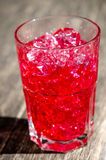 Red cocktail in glass with ice. Closeup of red ice in cocktail with ice royalty free stock images