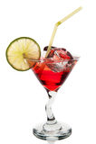 Red cocktail with ice cubes and lime Royalty Free Stock Images