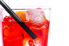 Red cocktail with ice cubes and straw on white background Royalty Free Stock Image