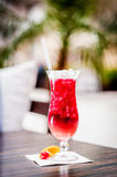 Red cocktail with ice. Red fruit cocktail with ice, on the table Stock Images