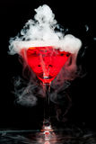 Red cocktail with ice vapor. On black background Stock Photo