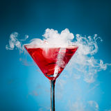 Red cocktail with ice vapor Royalty Free Stock Photos