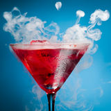 Red cocktail with ice vapor Royalty Free Stock Images