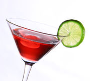Red cocktail with lime Royalty Free Stock Image