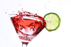 Red cocktail with lime on white Royalty Free Stock Photo