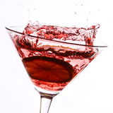 Red cocktail with lime on white Royalty Free Stock Images