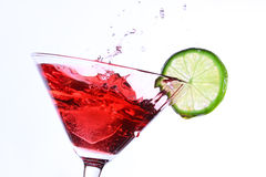 Red cocktail with lime on white Royalty Free Stock Photos