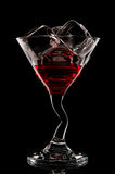 Red cocktail. Liquor, martini or cosmopolitan in a glass on a black background. Stock Photo