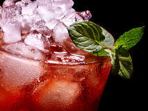 Red cocktail  and mint on dark background Royalty Free Stock Photography