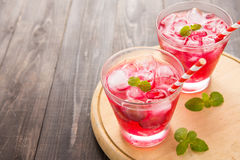Red Cocktail with mint and ice on wooden table Stock Photography