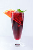 Red cocktail with orange, ice and mint Stock Images