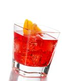 Red cocktail with orange slice tilted isolated on white background Stock Photography