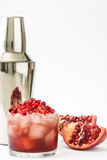 Red cocktail with pomegranate and shaker isolated. On white background royalty free stock photography