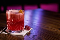 Red cocktail, with raspberry and vanilla on sides stock photography
