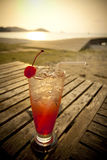 Red cocktail by the sea Royalty Free Stock Photography