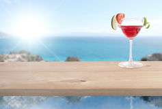 Red cocktail by the sea Royalty Free Stock Photos