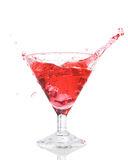 Red cocktail splash in the glass isolated Royalty Free Stock Photos