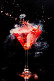 Red cocktail with splash Stock Photography