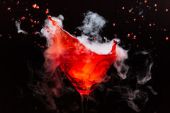Red cocktail with splash royalty free stock images