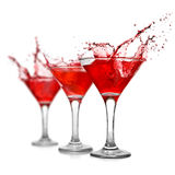 Red cocktail with splash isolated Stock Photography