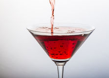 Red cocktail with splash on white Stock Images