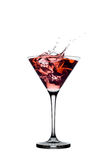 Red cocktail with splashes isolated on white Royalty Free Stock Photos