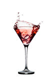 Red cocktail with splashes isolated on white Stock Photography