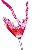 Red cocktail with splashing in the tilted glass Stock Image