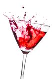Red cocktail with splashing in the tilted glass Stock Photo
