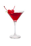 Red cocktail with two cherries. Isolated on white Royalty Free Stock Photos