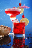 Red cocktails on blue Royalty Free Stock Images