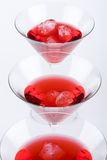 Red cocktails in a row Stock Photography