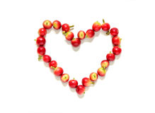 Red coffee beans  berries in heart shape. Stock Photos