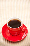 Red coffee cup. On tablecloth Stock Image
