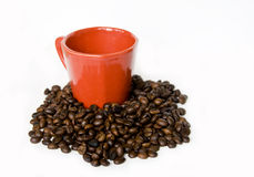 Red Coffee Cup And Coffee Beans Stock Photos