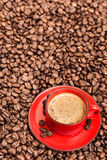 Red coffee cup and beans Stock Images