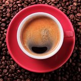 Red coffee cup black espresso roasted beans closeup top view Royalty Free Stock Photo