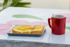 Red coffee cup with bread Stock Photography