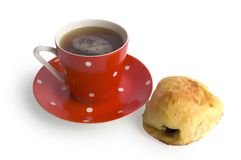 Red coffee cup and a bun Stock Photos