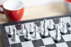 Red coffee cup and chess board. For relax time idea royalty free stock images