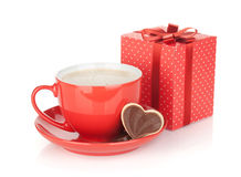 Red coffee cup, chocolate cookie and gift box Royalty Free Stock Image