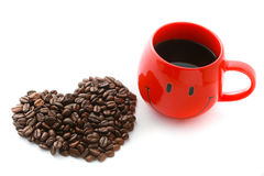 Red Coffee Cup and Coffee beans in heart shape Stock Photo