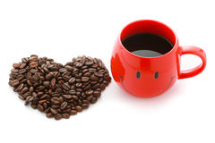 Red Coffee Cup and Coffee beans in heart shape Stock Photography