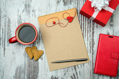 Red coffee cup, empty notepad and heart cookies. Stock Images