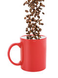 Red coffee cup with falling coffee beans Royalty Free Stock Image