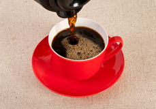Red coffee cup filled with black expresso Royalty Free Stock Image
