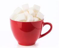 Red coffee cup filled with sugar cubes Stock Photos